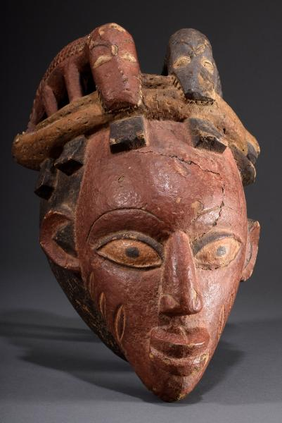 Gelede mask with tattoos on the face and sculptural attachment