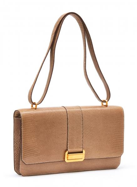 HERMÈS PARIS MADE IN FRANCE  - 1980.  - A POCHETTE made of beige lizard leather [...]