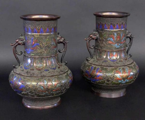 A PAIR OF HANDLED CLOISONNE VASES probably Japan, Meiji period. Bronze with relief