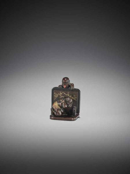 SHUNSAI: AN UNUSUAL LACQUERED WOOD OKIMONO-NETSUKE OF JIZO AND ONI