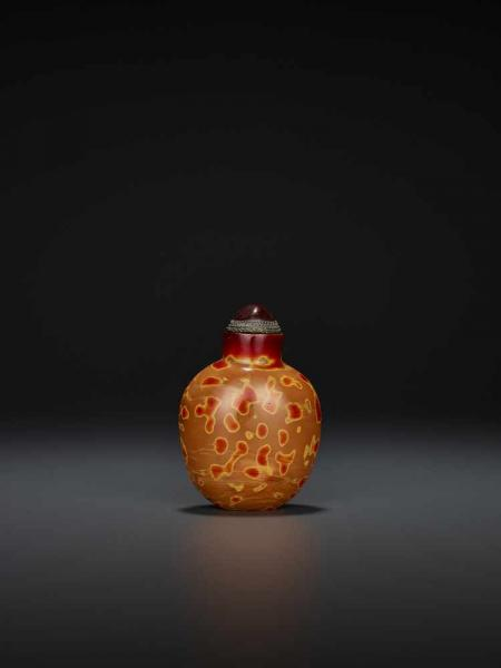 A REALGAR GLASS SNUFF BOTTLE China, 18th-19th century. The bottle is of slightly [...]