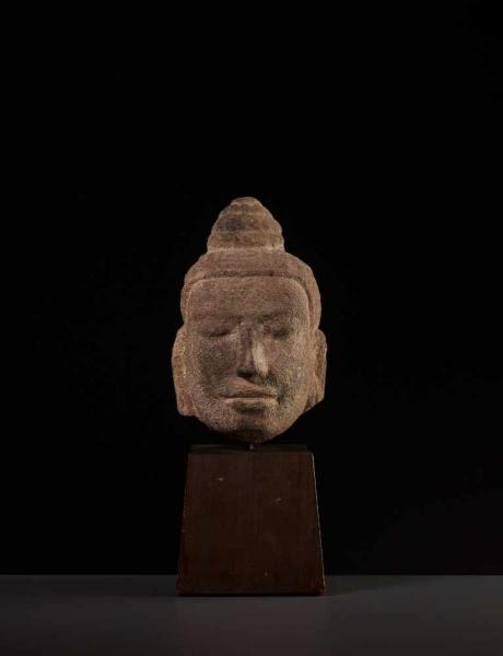 A FINE SANDSTONE HEAD OF BUDDHA, KHMER Cambodia, 11th-12th century. The face with a [...]