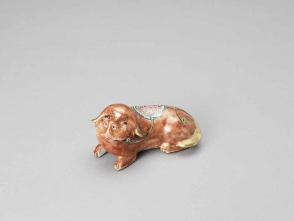 A FAMILLE ROSE PORCELAIN DOG, QING