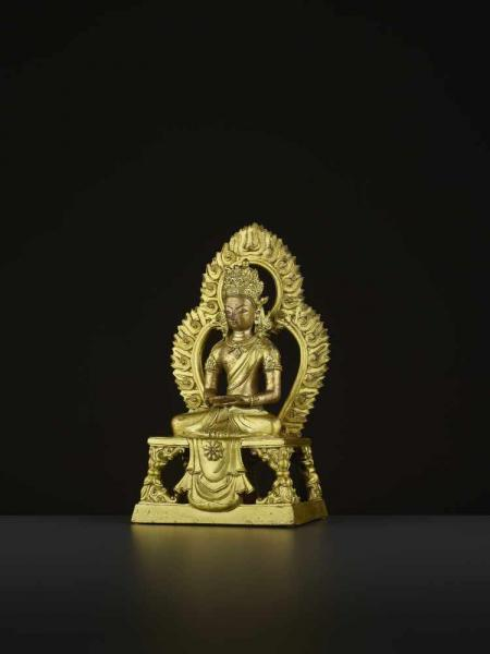 A GILT-BRONZE FIGURE OF AMITAYUS, QIANLONG China, 1736-1795. The figure is finely [...]