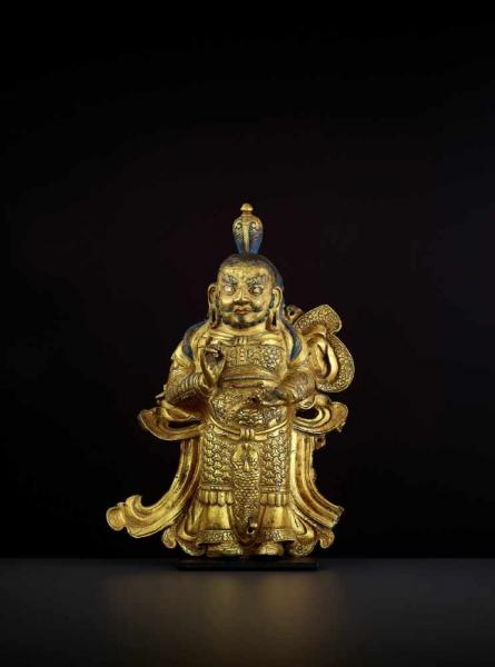 A GILT COPPER GUARDIAN KING, TIBET 17TH CENTURY In this imposing Densatil school [...]