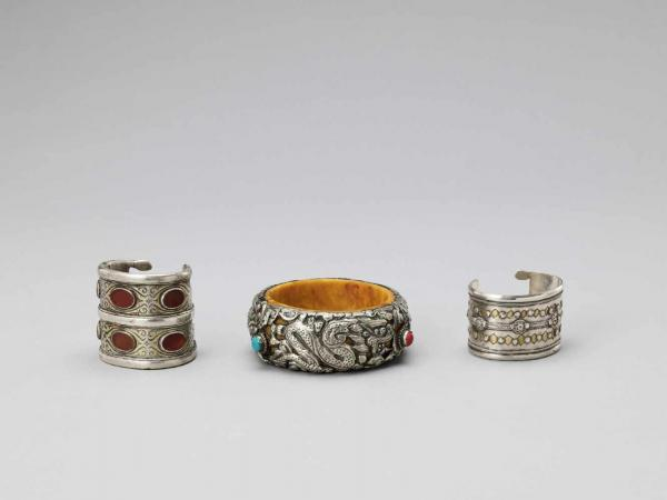 THREE PARCEL-GILT AND GEMSTONE-INLAID SILVER BANGLES, LATE 19TH TO EARLY 20TH CENTURY