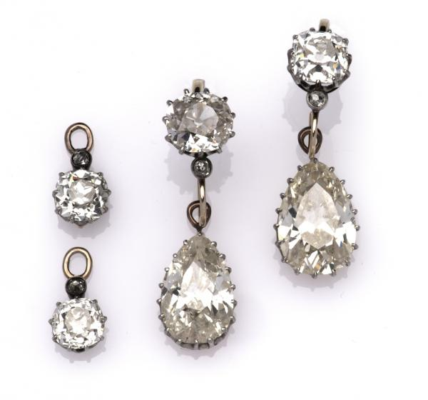 A pair of antique diamond earrings, Each set with a pear-shaped diamond weighing [...]