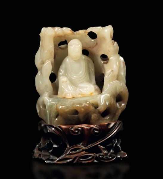 A white jade and russet group, China, Qing Dynasty - Qianlong period (1736-1796). H [...]