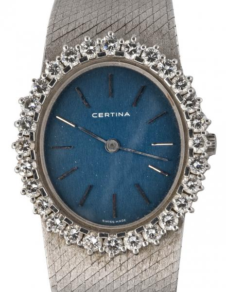 CERTINA - Montre de dame en or gris - Lunette ornée de brillants totalisant environ [...]