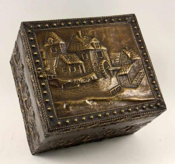 A BOX Belgium ca. 1900 Wooden box with brass and relief decoration. Hinged lid with lock