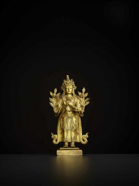 A GILT-BRONZE MAITREYA, 18TH CENTURY China. The finely cast standing figure with hands in