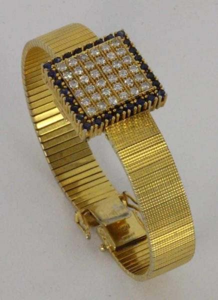 ''A LADIES JEWELLERY WRISTWATCH, ''ETERNA'' 750/000 yellow gold. Hinged lid set with 36