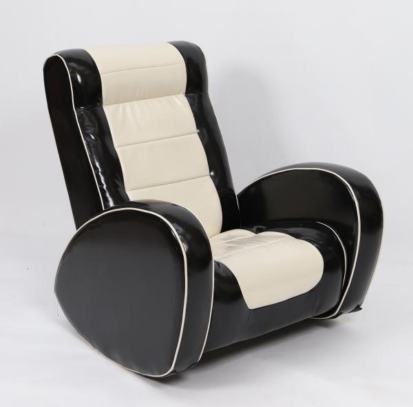 Rocking chair En simili matelassé noir et blanc. Etat d'usage, design 70's. Epoque [...]