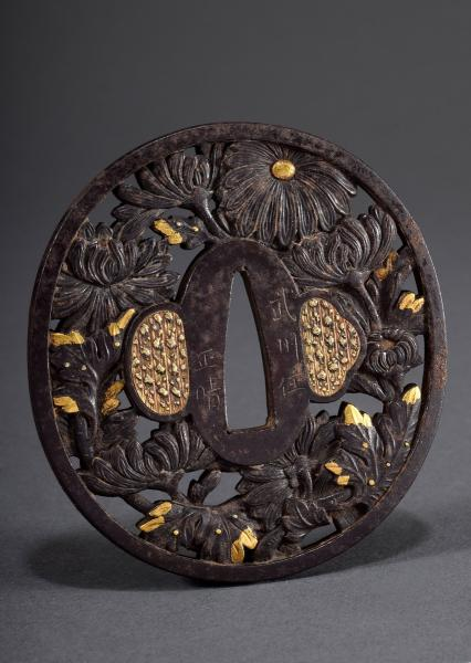 Japanese iron tsuba with openwork relief