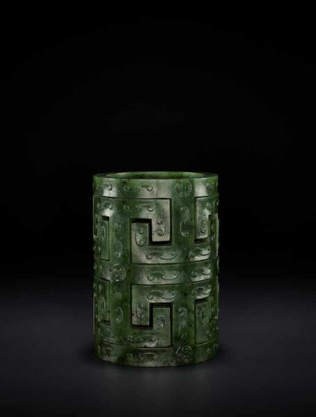 AN ARCHAISTIC SPINACH GREEN JADE BRUSH HOLDER, QING China, second half of the Qing [...]