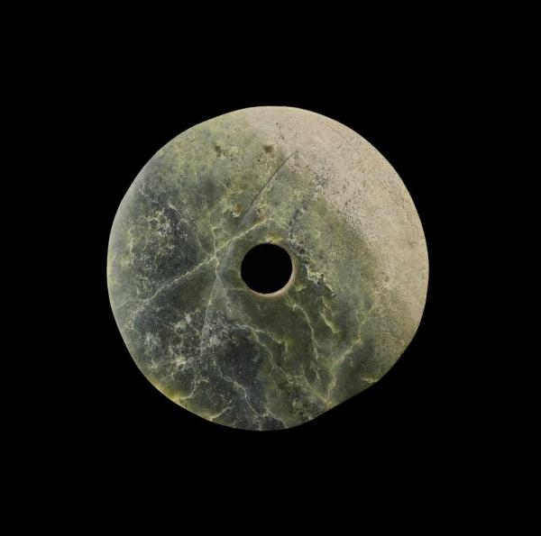 A LARGE GREEN JADE BI DISC China, Liangzhu culture, 3300-2200 BC. The opaque green [...]