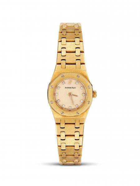 AUDEMARS PIGUET MINI ROYAL OAK LADY  - cassa in oro giallo 18kt, quadrante color [...]