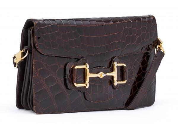 CÉLINE PARIS  -   - A POCHETTE made of brown crocodile leather. Gold-colour metal [...]