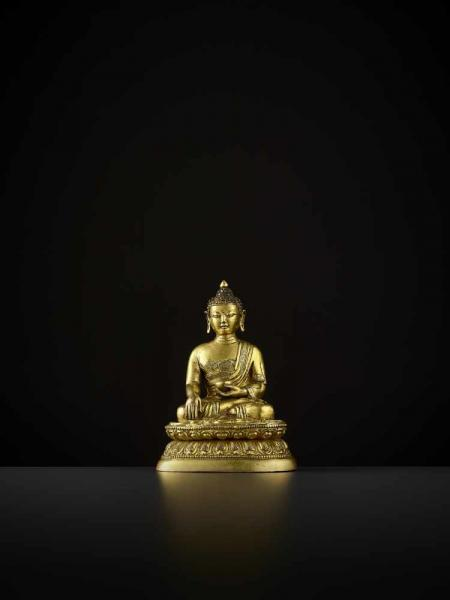 A GILT BRONZE BUDDHA, QIANLONG China, 1736-1795. The Medicine Buddha is seated in [...]