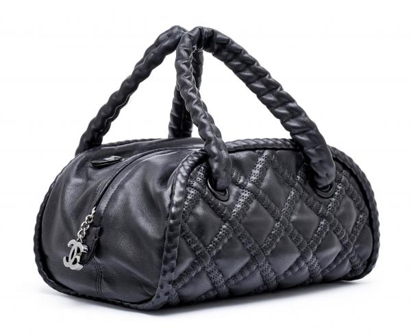 * CHANEL  - 2006-08.  - A BOWLER BAG made of black lamb leather. Silver-colour metal [...]